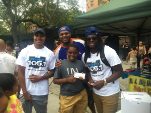 "Sharieff ""The Fitness Sheriff,"" DJ BSmoove, and Colin Olufemi from Power 105.1 with a concert ticket winner."