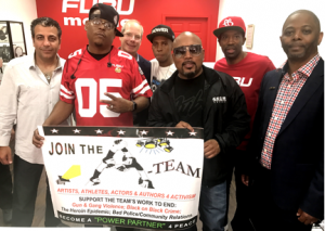 "A-TEAM Members Left to right include: FUBU Mobile Executive Chairman, Albert Benjamin; FUBU members Keith Perrin, ""The Shark"" Daymond John, Jay Alexander Martin and Carl Brown. In the back row, FUBU partner Bruce Weisfeld with Hip-Hop Summit Youth Council Founder Charles Fisher. The A-TEAM Members who are also ""POWER PARTNERS 4 PEACE"" will work with the Hip-Hop Summit Youth Council, Power 105.1. and FUBU Mobile to address the following social issues that have a negative impact on many of our communities: Gun & Gang Violence; The Heroin & Opioid Epidemic; Black on Black Crime; and Police/Community Relations. By joining the A-TEAM you can help us improve Public Safety and Empower local communities with the resources they need to WIN."