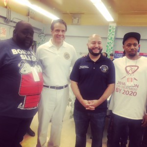 L to R: Danny Barber (NYCHA CCOP President), NYS Gov. Andrew Cuomo, NYC Councilmember Salamarca, Randy Fisher (HHSYC)